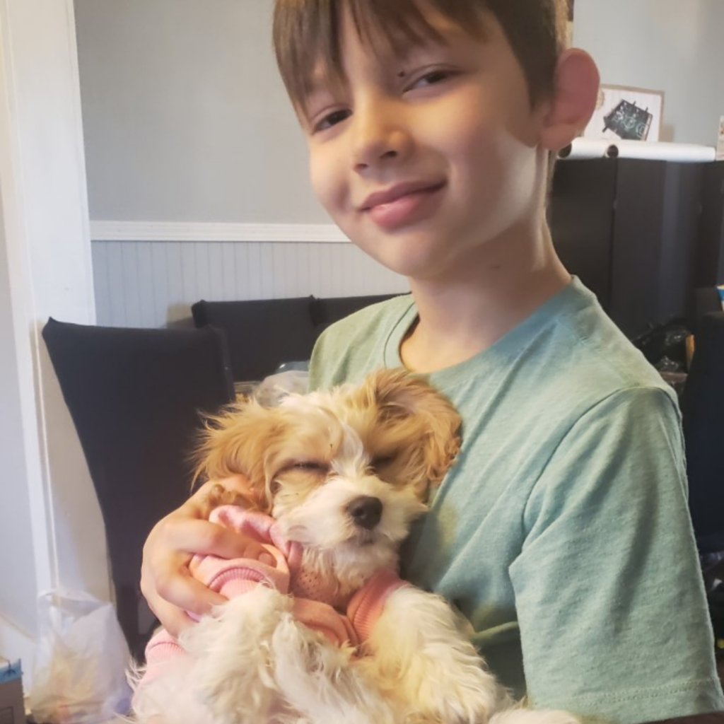 Jacob with puppy named Peaches