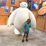 Girl with cerebral palsy with Baymax from Big Hero 6