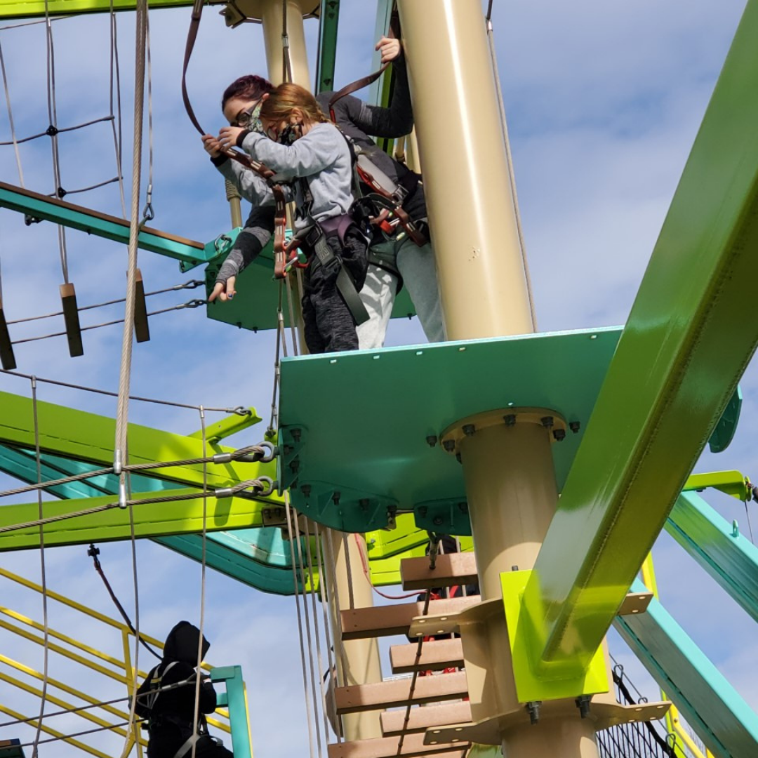 boy on a ropes course