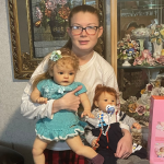 Girl with intellectual disability holding her new real baby dolls