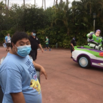 Teen boy with Buzz Lightyear at Disney