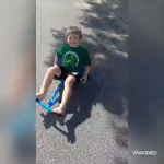 Boy with hearing loss enjoy a ride-on toy