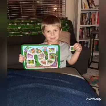 Boy with hearing loss holding electronic learning toy