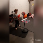 Boy with hearing loss with his toy boxing stand