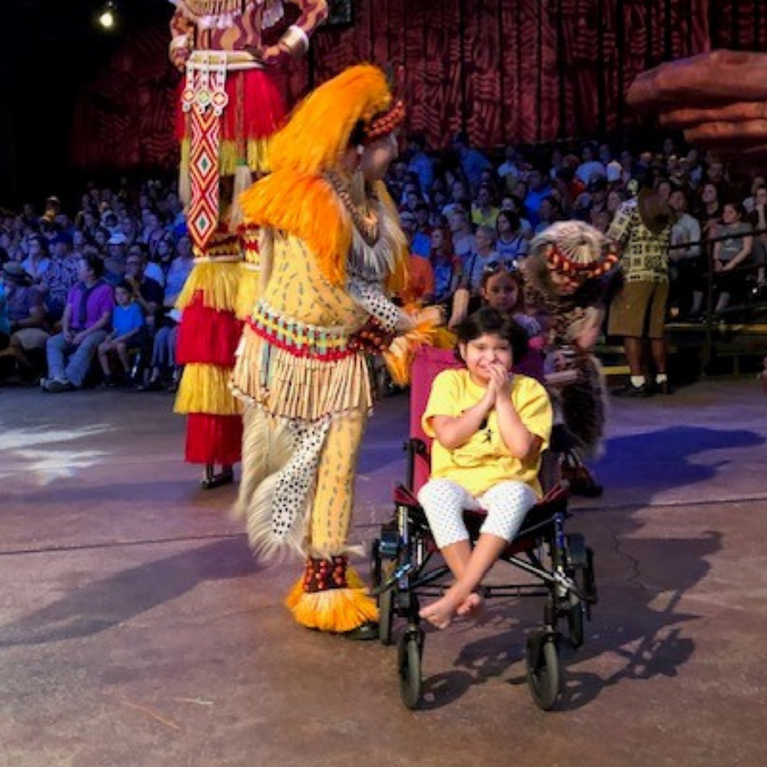 Girl in wheelchair participating in Animal Kingdom's Lion King show