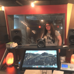 Teen girl learns how to record music at studio