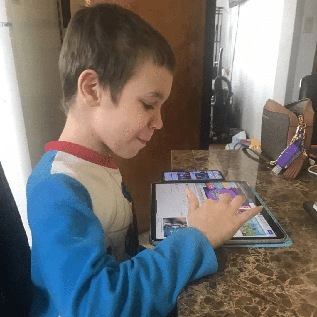 10-year-old boy with low-functioning autism enjoys his new iPad